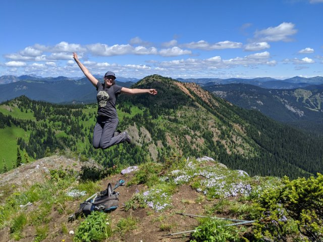 Jumping in front of Red Mountain