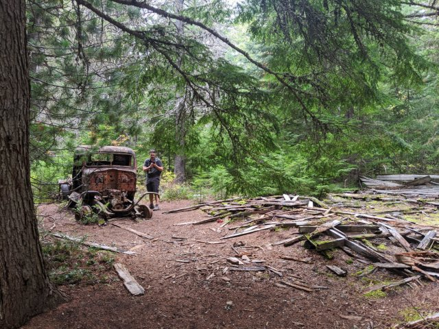 Piles of wood and a very dead car in Parkhurt Ghost Town