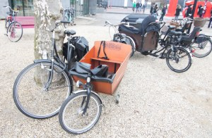 Bikes with attached cart-style child carriers