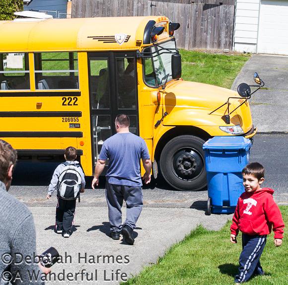 Chris walking Ian down to the school bus before school.