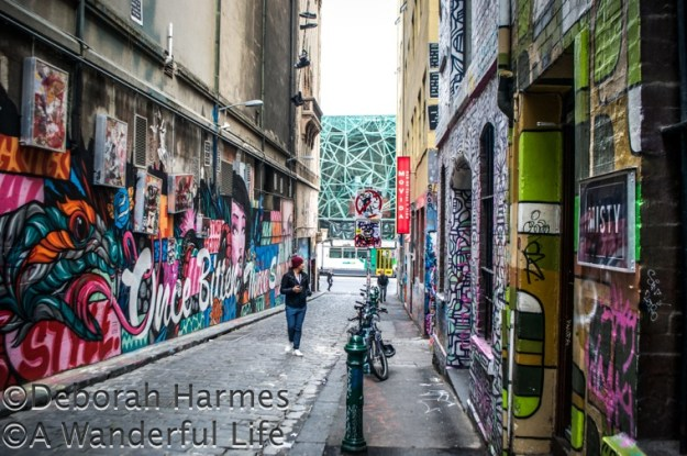 Graffiti covered Hosier Lane in the heart of Melbourne, Australia with the Federation Square entry to the NGV Ian Potter art museum at the end of the laneway across Flinders Street