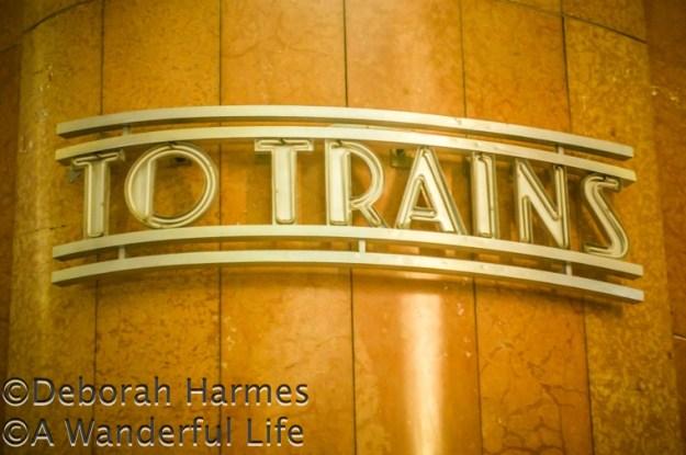 """To Trains"" sign in an Art Deco station built in the 1930s"