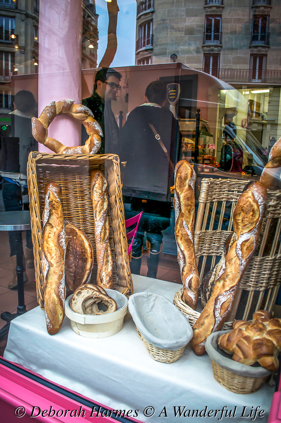Boulangerie window displaying bread for sale in Paris, France