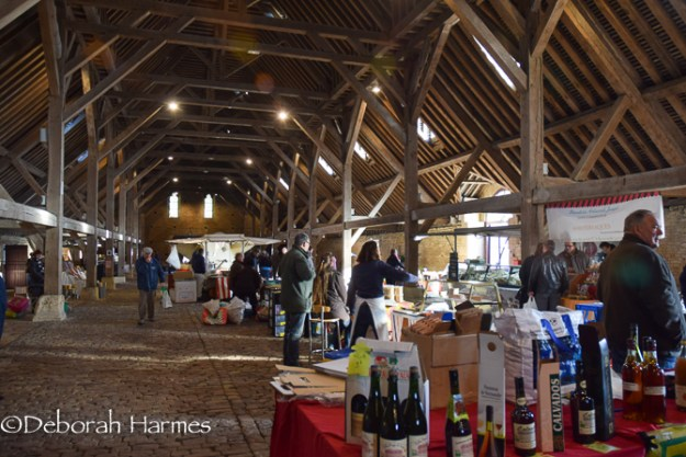 Inside the historic medieval market hall at Saint-Pierre-sur-Dives.