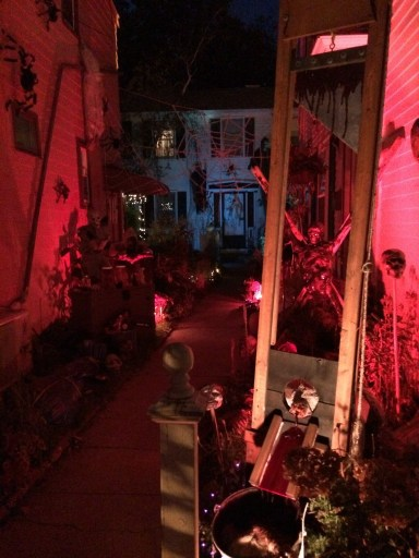 A creepy decorated alleyway.