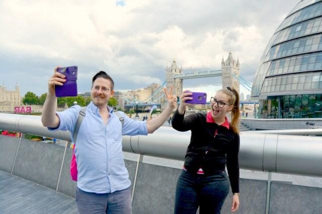 Selfies in front of the Tower Bridge in London