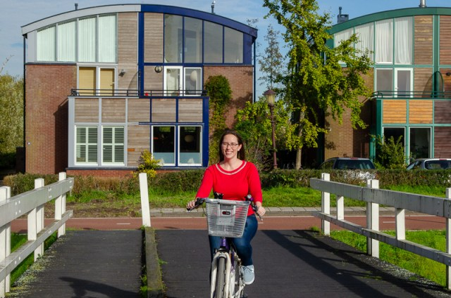 Jessica on bike on bridge in Amsterdam