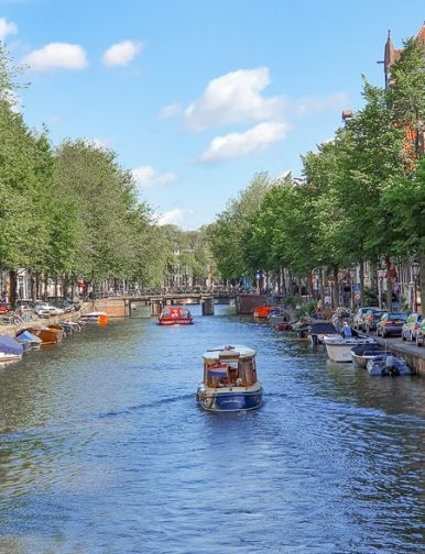 boat in amsterdam canal vertical