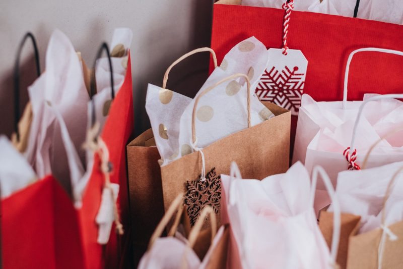From: freestocks on unsplash | Mulitple gift bags decorated in red and white