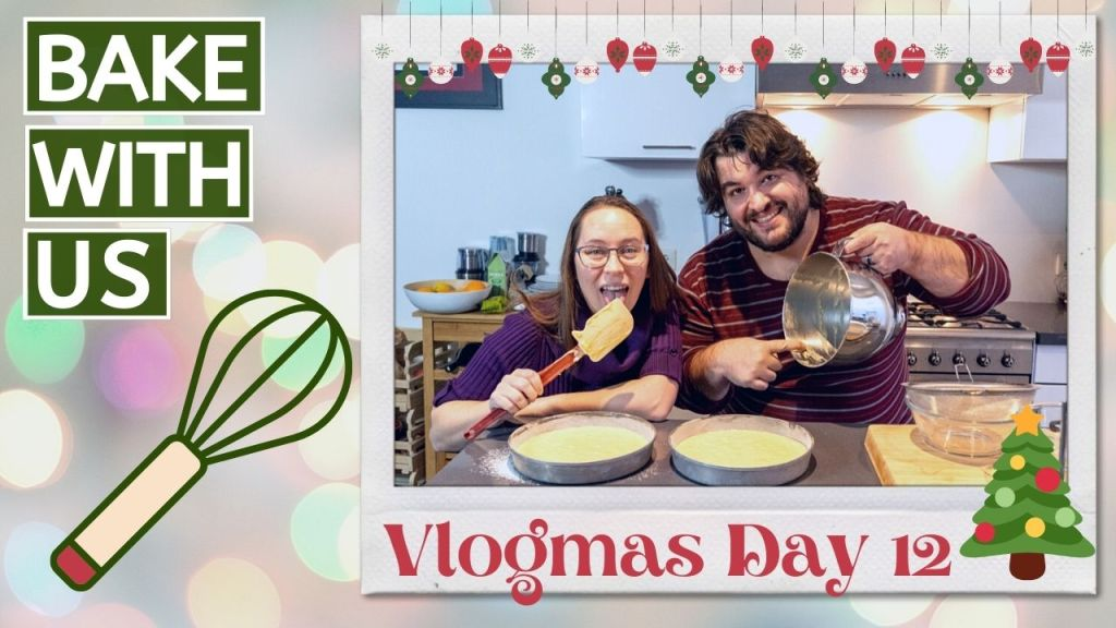 Vlogmas day 12-2020 Thumbnail with Sean and Jess licking batter from the bowl and spatcula over 2 round, filled cake pans