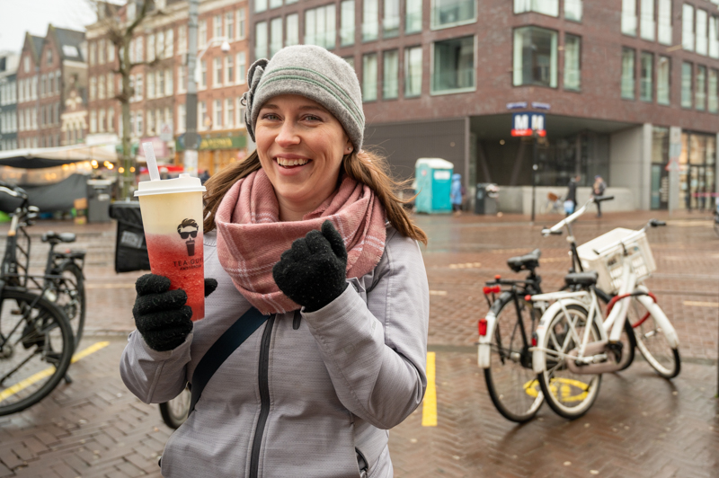 Jessica holding a strawberry and cream cheese bubble tea from Tea Guys Amsterdam