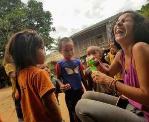 Playing with kids of Khamu minority, Laos