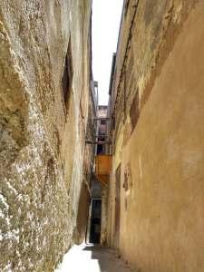 Typical narrow street in Medina of Fez