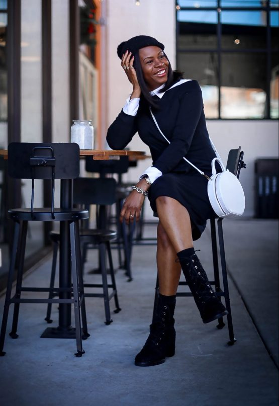 Black sweater dress worn with black combat boots by stuart weitzman. Atlanta blogger wearing white bag and fall winter fashion trends-9