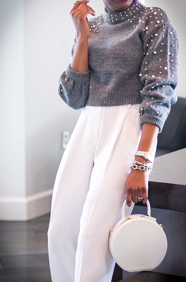 Atlanta fashion blogger wearing grey crop sweater with pearl details and white wide-leg pants. white circle bag and valentino rockstuds. Cold weather glam-1