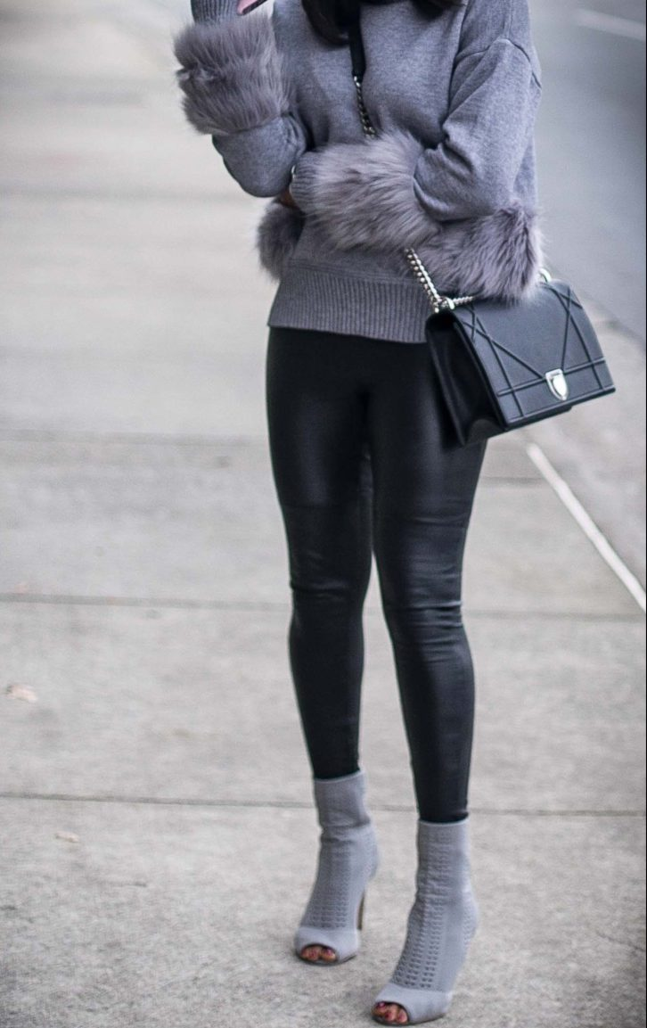 Atlanta fashion blogger wearing leather leggings, grey sweater with fur details and grey sock booties.-7