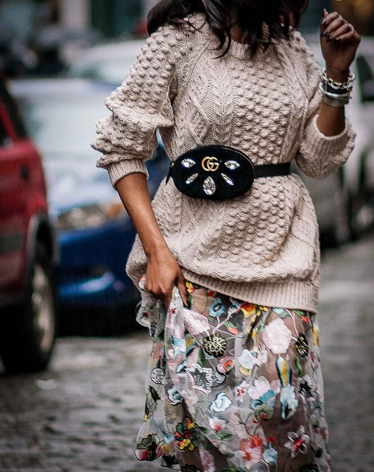 Chunky beige sweater worn with long floral dress, gucci waist bag, gucci square sunglasses, and black booties worn by Atlanta Fashion blogger. Influencer-2