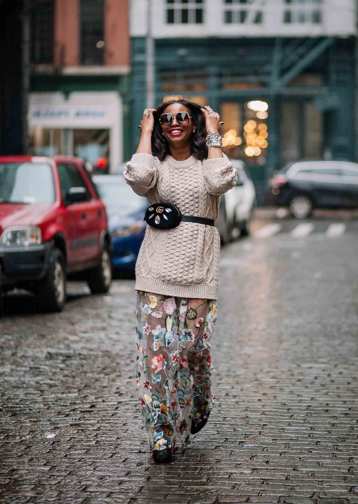 Chunky beige sweater worn with long floral dress, gucci waist bag, gucci square sunglasses, and black booties worn by Atlanta Fashion blogger. Influencer-5