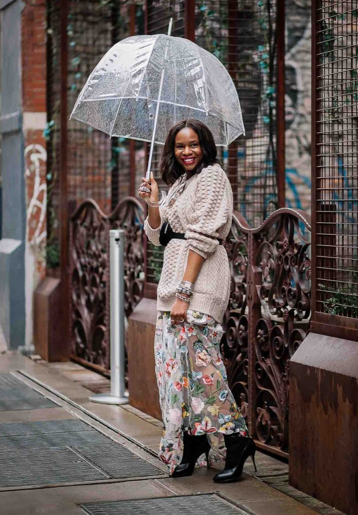 Chunky beige sweater worn with long floral dress, gucci waist bag, gucci square sunglasses, and black booties worn by Atlanta Fashion blogger. Influencer-9