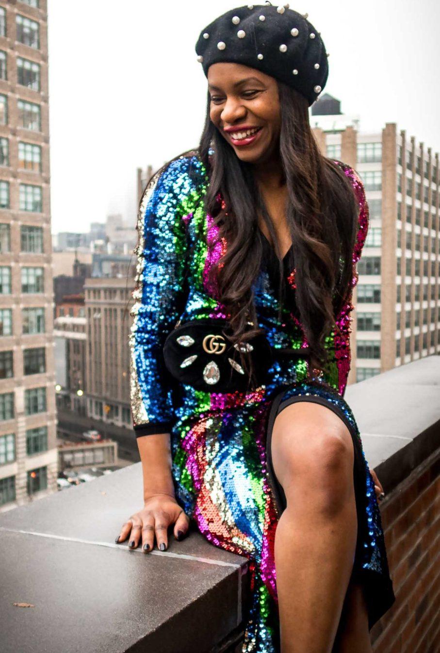 Fashion blogger wearing rainbow sequin dress during new york fashion week. sequin dress worn with berret, and alexandre birman sandals-3