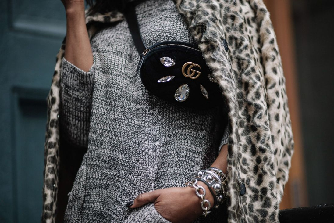 Fashion blogger wearing sweater dress with gucci waist bag and gucci sunglasses during NYFW8