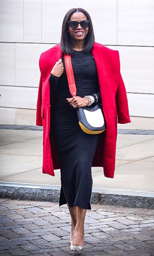 How to style a red coat for NYFW. Red H&M coat worn with black fitted midi dress, snake skin pumps and coloful bag by Atlanta fashion and lifestyle blogger -2