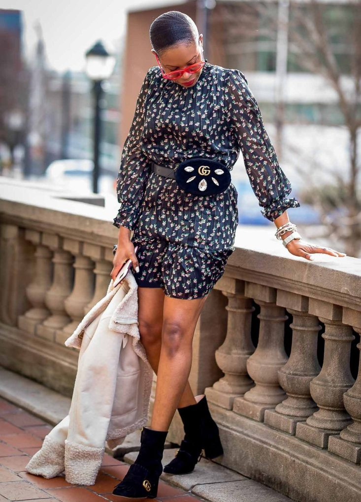 how to style a floral mini dress in the winter. floral dress worn with gucci suede booties, gucci waist bag and le spec sunglasses-11