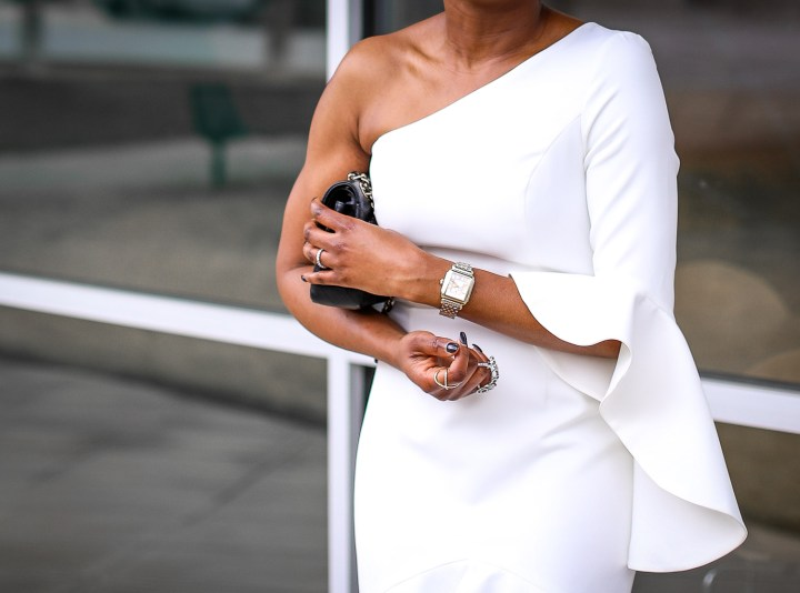Fashion blogger wearing a white ruffle dress by frame and partners. Dress worn with Moschino pointed sunglasses, chanel bag and christian dior pumps. #Atlanta blogger -16