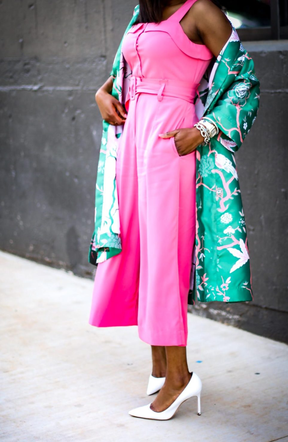 Atlanta fashion blogger wearing Gabrielle union for New York and Compnay spring pink jumpsuit and green floral kimono and white pumps by manolo blahink-5