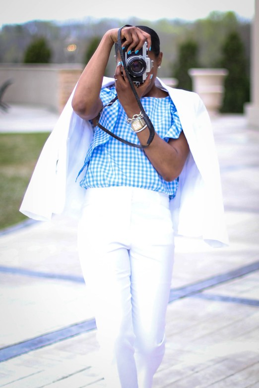 Atlanta fashion blogger wearing a white spring suit and blue and white gingham blouse, matched with white converse sneakers exploring a vineyard-8