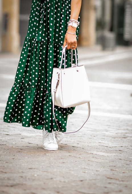 how to wear dots for spring. green and white dot maxi dress worn with white henri bendel bag, straw hat and white sneakers by atlanta fashion blogger. images taken at the shops buckhead atlanta-18