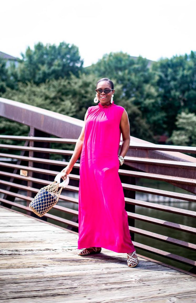 Fashion blogger Monica Awe-Etuk of Awed by Monica wearing a pink other stories dress with white j.crew sandals, a staud bucket bag, white baublebar earrings and zara cat-eye sunglasses-2