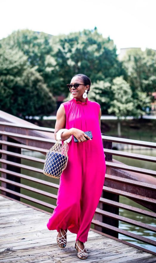 Fashion blogger Monica Awe-Etuk of Awed by Monica wearing a pink other stories dress with white j.crew sandals, a staud bucket bag, white baublebar earrings and zara cat-eye sunglasses