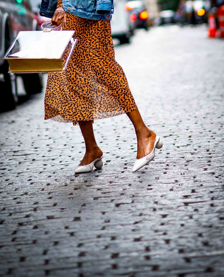 Atlanta fashion and style blogger wearing leopard midi dress from Other Stories with a j.crew denim jacket, cult gaia mules and chloe heart sunglasses-5