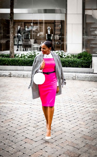 Fashion blogger Monica Awe-Etuk wearing a pink dress and plaid jacket from stage in celebration of breast cancer awareness month-4