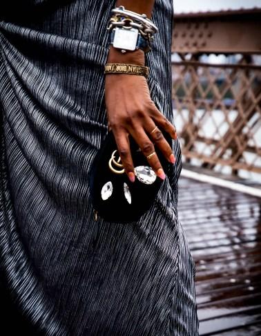Atlanta lifestyle blogger Monica Awe-Etuk on the brooklyn bridge in new york city weaing a long metallic dress, gucci belt bag and tory burch feather mules-9