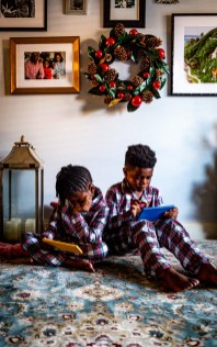 Fashion blogger Monica Awe-Etuk and her family wearing matching family pajamas in plaid from macy's for the holidays. plaid family pajama set. holiday gifts