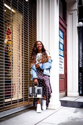 Atlanta blogger wearing moschino t-shirt and ganni polkadot midi skirt and dad sneakersF5A1826-Edit