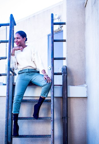 fashion blogger Monica Awe-Etuk shows you how to create a closet refresh with stylish, on-trend items on a budget from TJMaxx. Monica wearing a ivory knit sweater, theory cargo crop pants, all from TJMaxx, balenciaga booties and christian dior bracelet