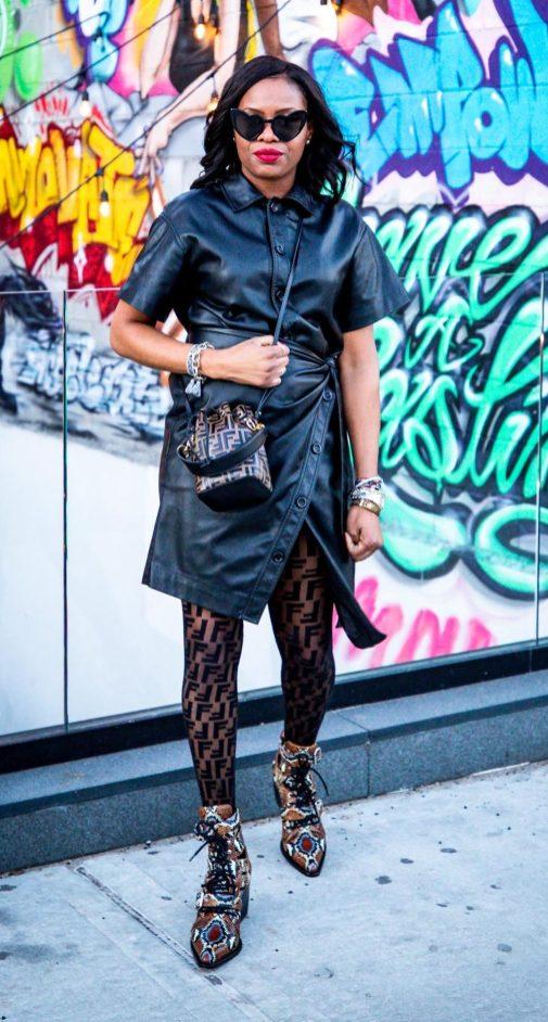 Atlanta lifestyle blogger Monica Awe-Etuk wearing -GOEN. J--Faux Leather Wrap Dress with chloe snake skin boots, fendi logo pantyhose, fendi logo bucket bag, and ysl heart sunglasses during nyfw-14