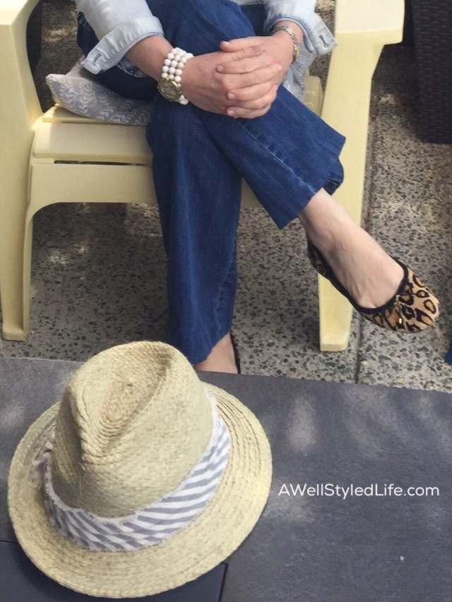 Leopard flats and a hat add fun to simple jeans