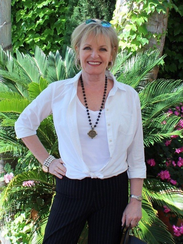 Jennifer Connolly of A well Styled Life wearing white blouse and black pants