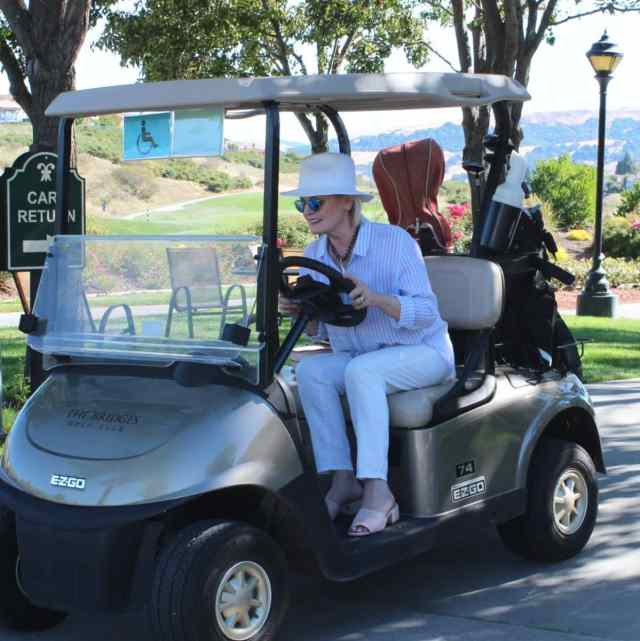 Jennifer Connolly of A Well Styled Life in a golf cart