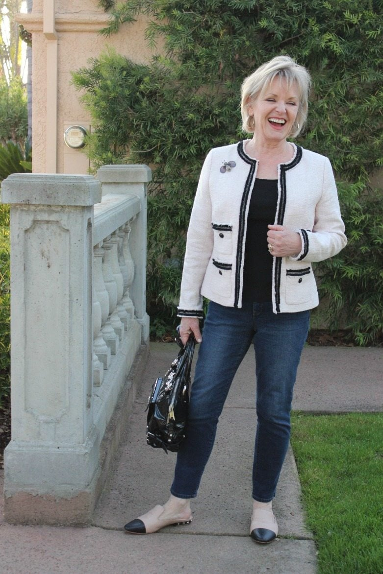 Jennifer Connolly of A Well Styled Life wearing tweed jacket and cap toed flats