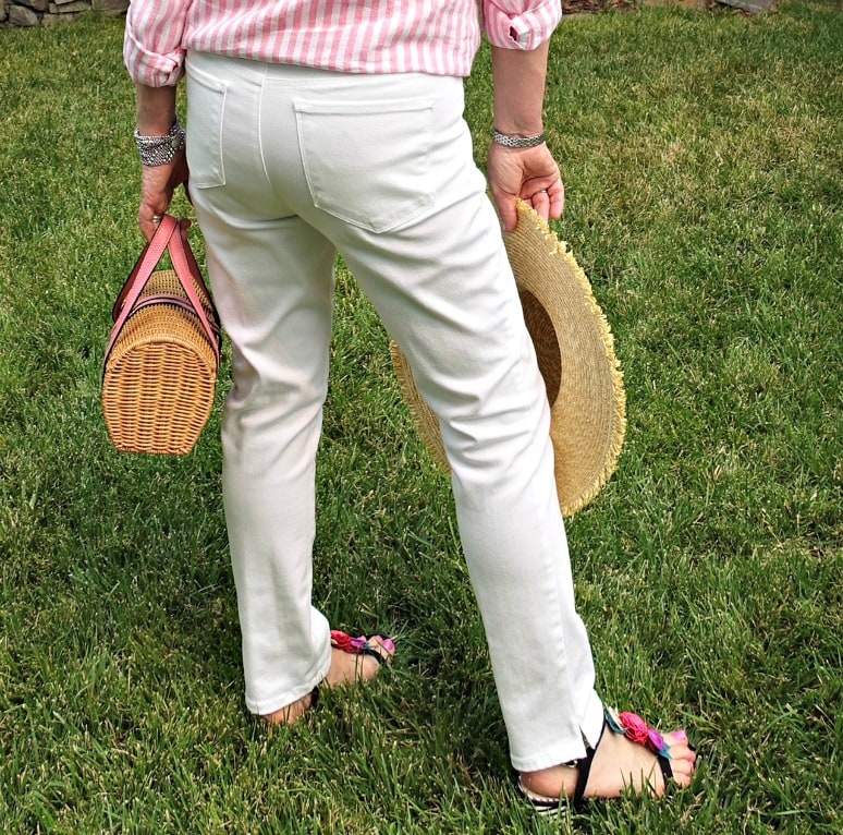 Jennifer Connolly of A Well Styled Life testing Always Discreet Boutique under white jeans