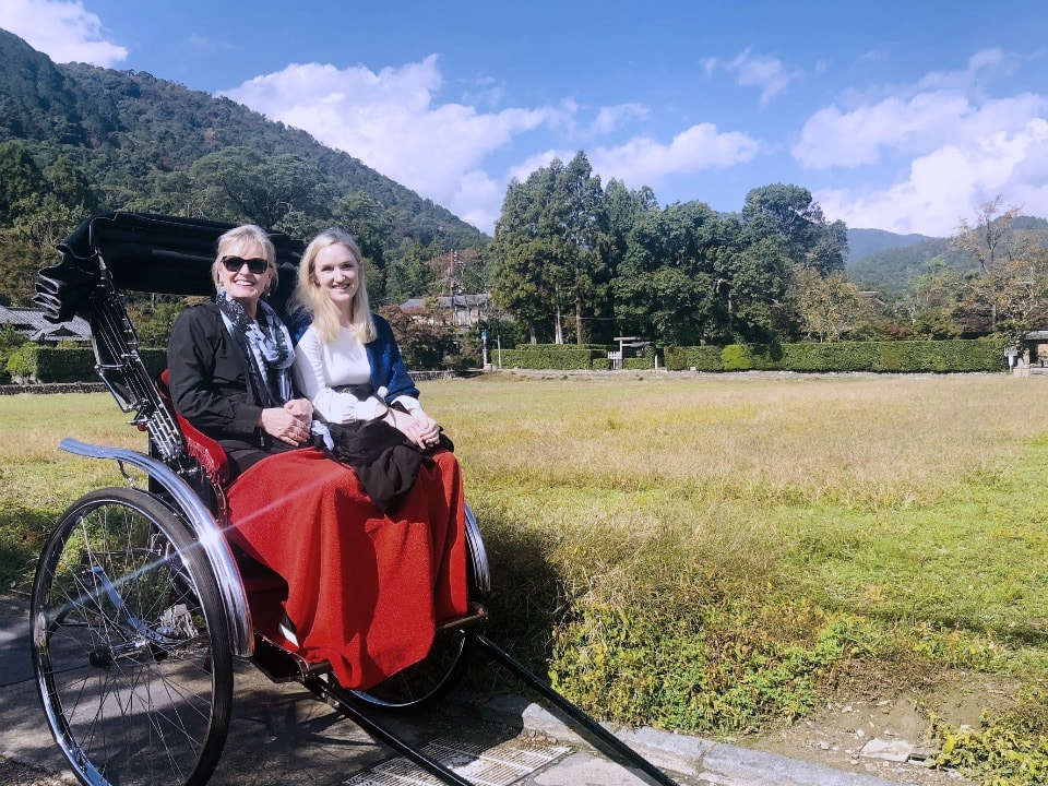 Jennifer and Vanessa Connolly of A Well Styled Life riding a rickshaw in Kyoto
