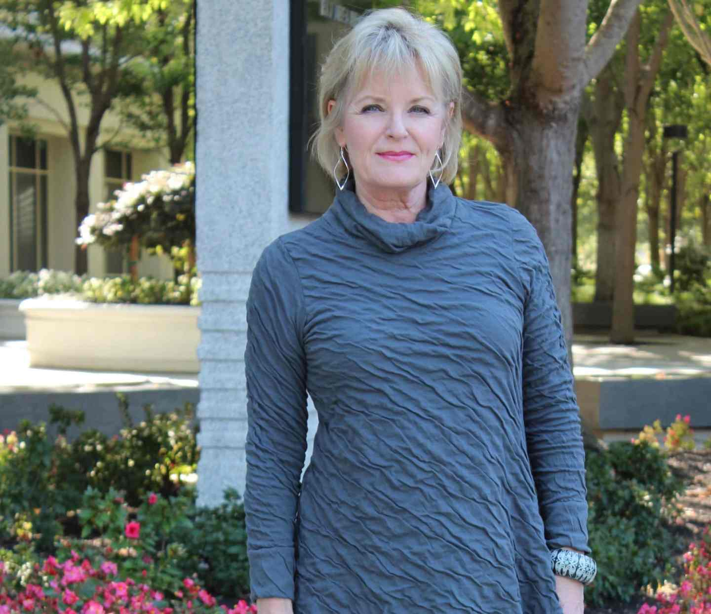 Jennifer Connolly of A Well Styled Life wearing a textured tunic which helps smooth the look of lines on your face