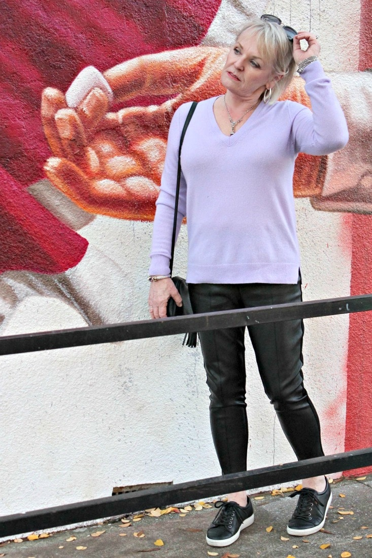 jennifer connolly from a well styled life wearing lavender v neck and black leggings from Ann Taylor