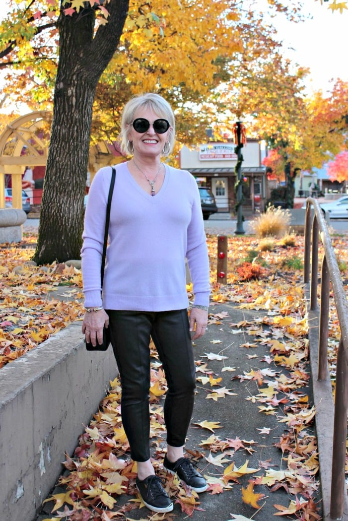 jennifer connolly of a well styled life wearing lavender cashmere v-neck over faux leather leggings with sneakers