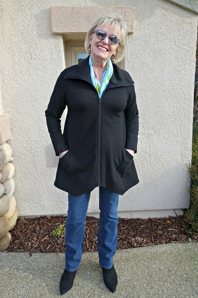 Jennifer Connolly of A Well Styled Life wearing a silk scarf in the neckline of a black jacket